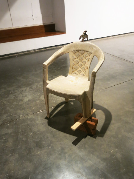 Huma Mulji The Flight Found Plastic Chair Taxidermy sparrow with plastic chair, plywood strip, bricks Dimensions variable  2014