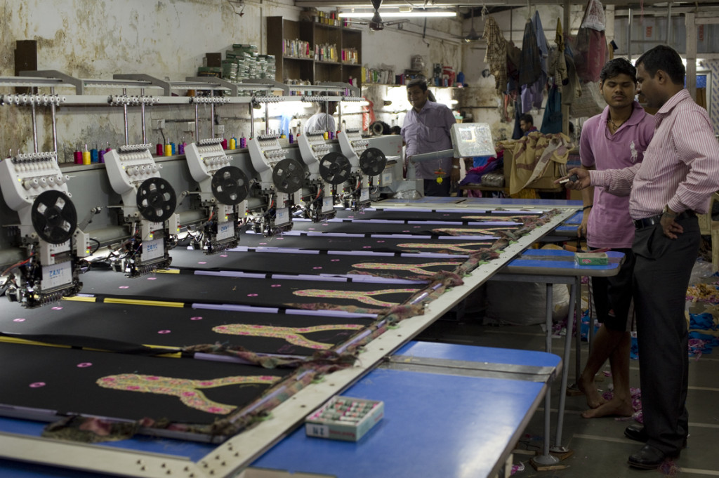 Workers supervise an embroidery unit at a textile mill in Dharavi, Mumbai.