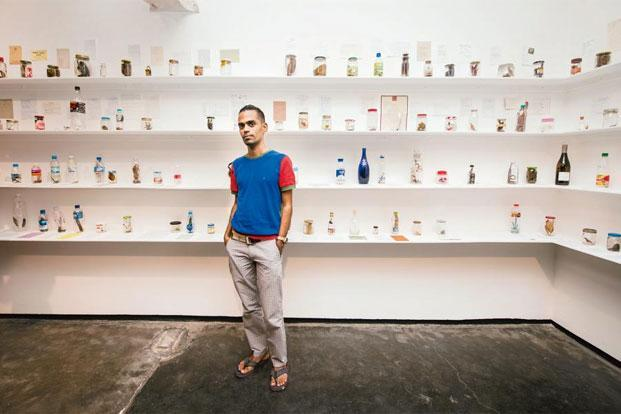 Baptist Coelho has collected 448 bottles for his installation 'Air (Travel).' Photo: Aniruddha Chowdhury/Mint